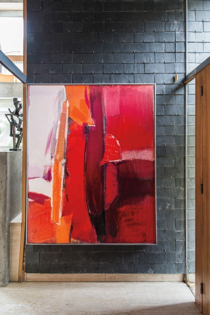 Take an International Tour of 5 Mid-Century Residences | bright red | large oversized abstract painting or print in modern residential interior design ideas