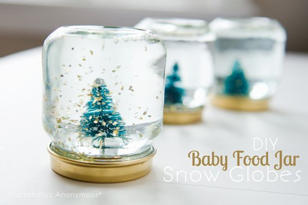Learn how to make Baby Food Jar Snow Globes! These mini snow globes are easy and fun to make with a few household items. Great gift idea! Christmas Craft.