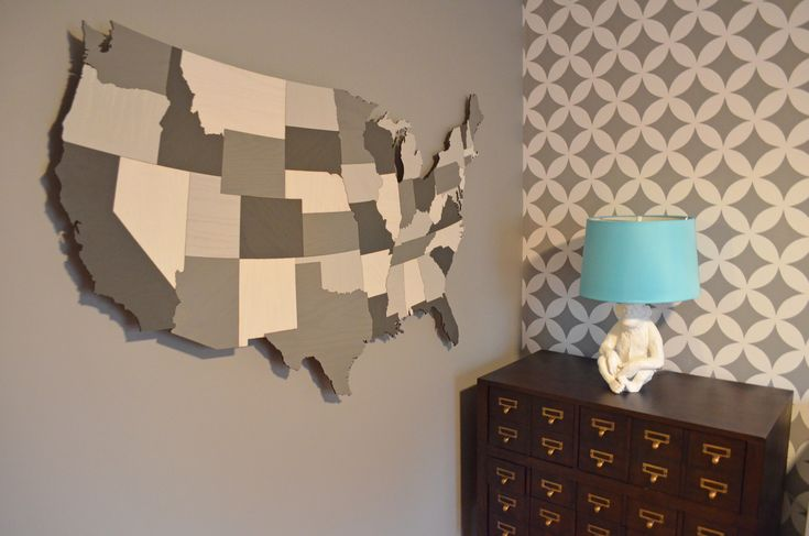 Wooden USA map from MastersOfFate on Etsy. Nagoya all-over stencil from cuttingedgestencils.com. Circulation dresser from Land of Nod. Monkey lamp from CB2.