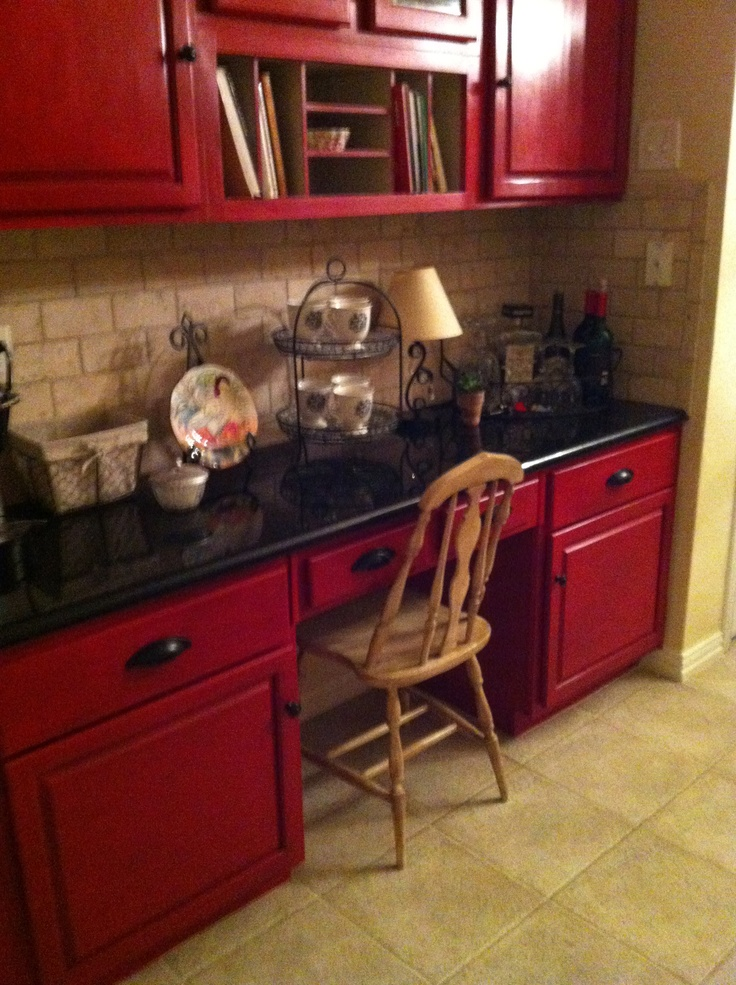 Red cabinets in kitchen painted with Annie Sloan paint!