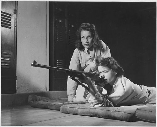 Marksmanship training for high schoolers at Roosevelt High School in Los Angeles, CA as apart of Victory Corps, 1942