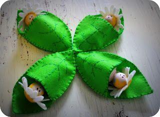 Little peg doll fairies in leaf sleeping bags