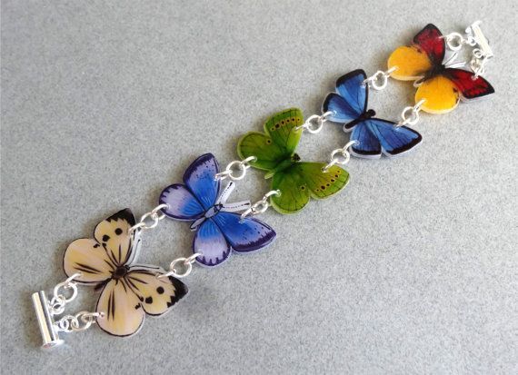 5 Butterflies BRACELET Plastic HANDMADE by by ShrinkArtDesigns. Pretty! I wonder how this shrinking plastic stuff works. . .