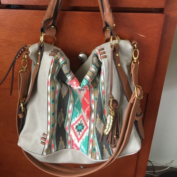 Jessica Simpson handbag  Cute southwestern style handbag  long shoulder strap included. Worn once. Perfect condition! Jessica Simpson Bags Shoulder Bags