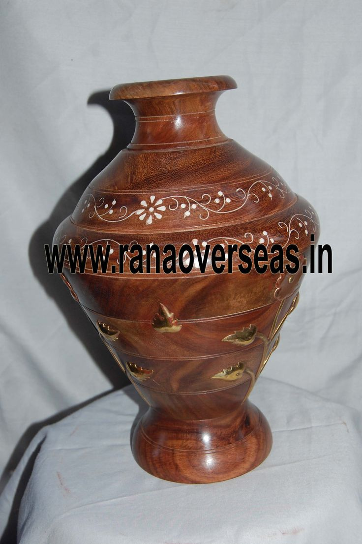 Various Sizes Are Available In These Wooden Flower Vases. Hand Work Is Also Done On Wooden Flower Pots, Wooden Vases.Our flower pots have gained immense popularity worldwide. Wooden Flower pots are available in a variety of sizes, designs and styles. The Wooden flower pots are sure to look new for years to come. They make exclusive gifts as decorative accents.