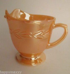 A lovely vintage milk jug in peach lustre.