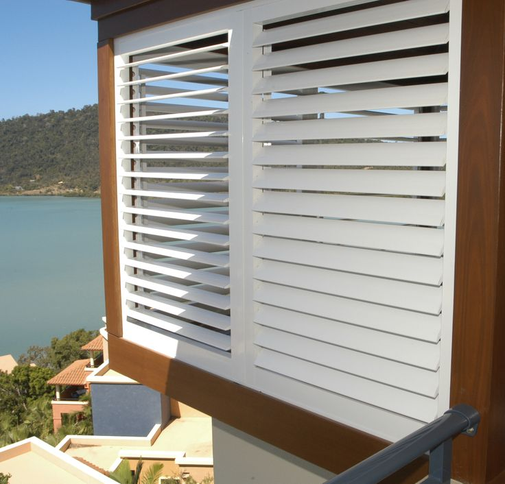 Exterior plantation shutters in white.