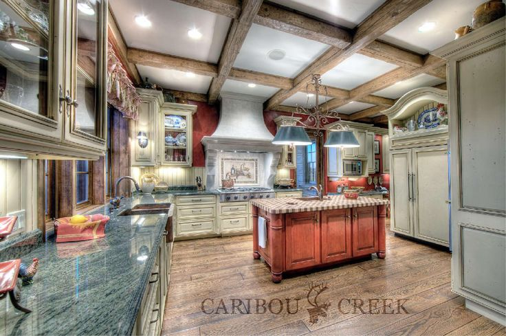 Rustic Log Accented Kitchen in a Dovetail Log Home