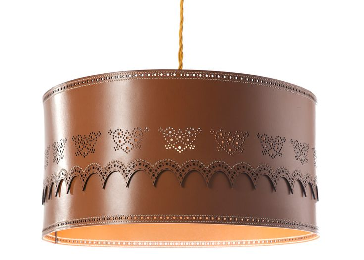 Brogue Light by Daniel Schofield for Deadgood.  This leather lampshade by British designer Daniel Schofield features a laser-cut pattern and stitching inspired by traditional British shoe-making techniques.