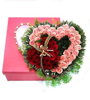 Heart Shaped Design of 35 pink roses and 25 red roses with green fillers in box. Stylish floral art in Vietnam. http://www.floristvietnam.com/148-your-heart.html
