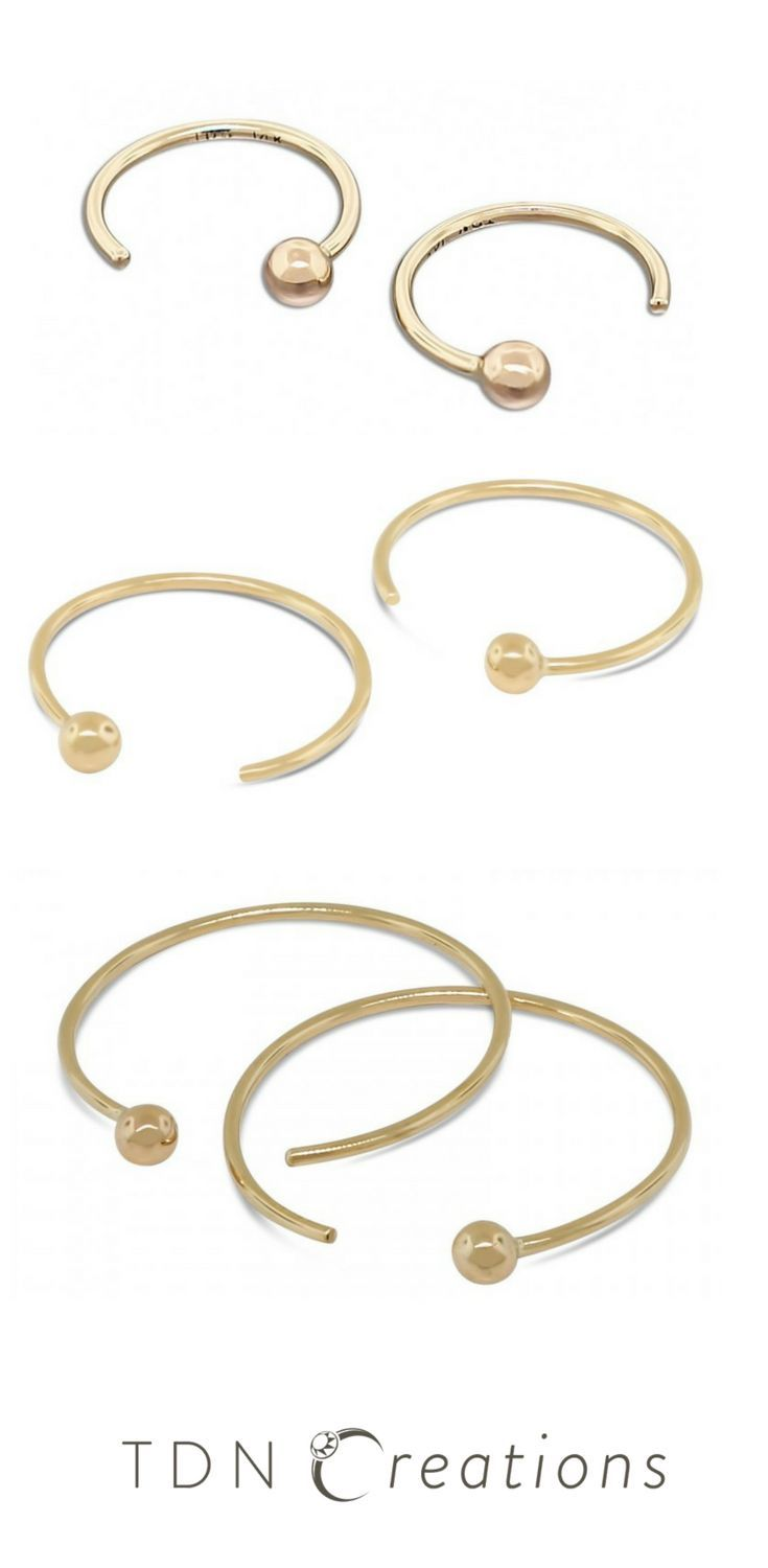 Gold Hoop Earrings, modern and minimalist everyday gold jewelry pieces.   These hoops are modern, minimalist and so comfortable you can wear them every day and forget you even have them on!
