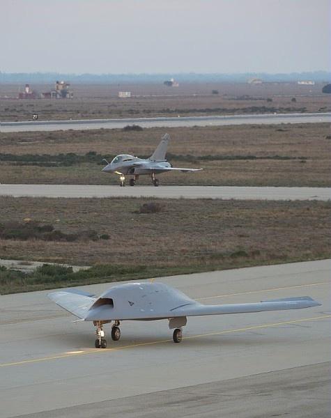 Dassault Neuron drone demonstrator, with Rafale behind.
