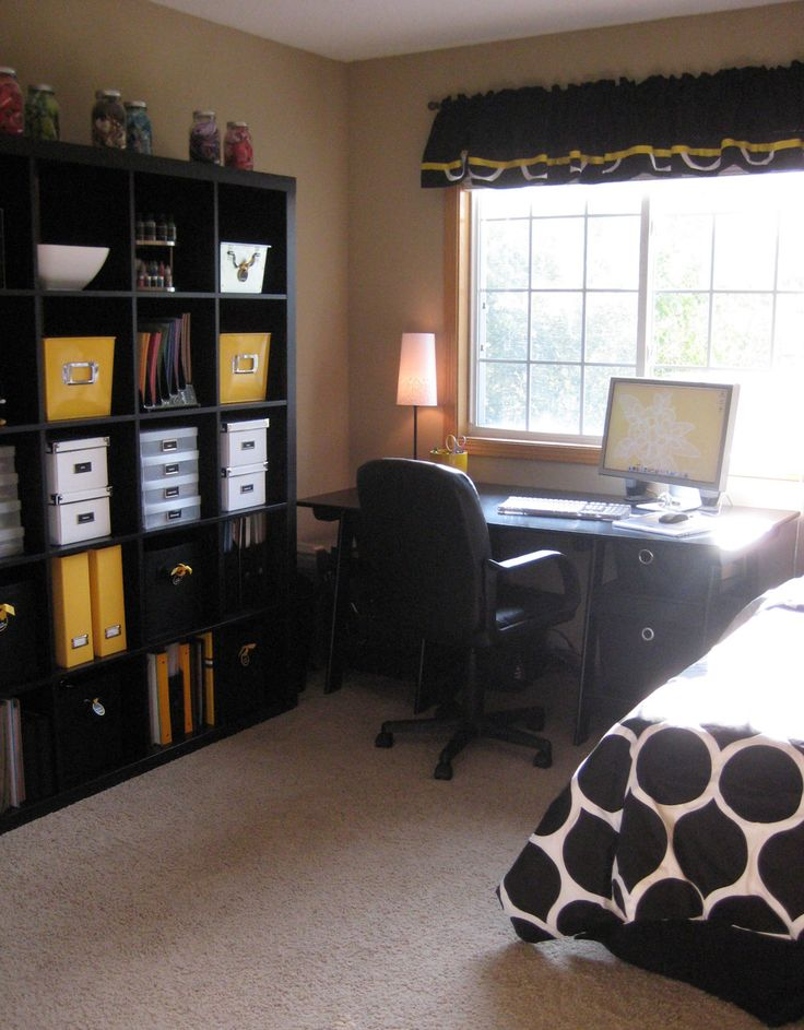 Guest room/office combo...like this setup   I Can get the square cubbies for storage from walmart (two side by side would be ideal)  and use that to store various photography STUFF... and then have the bed for the other half of the room with a dresser of some sort for guest accessories.