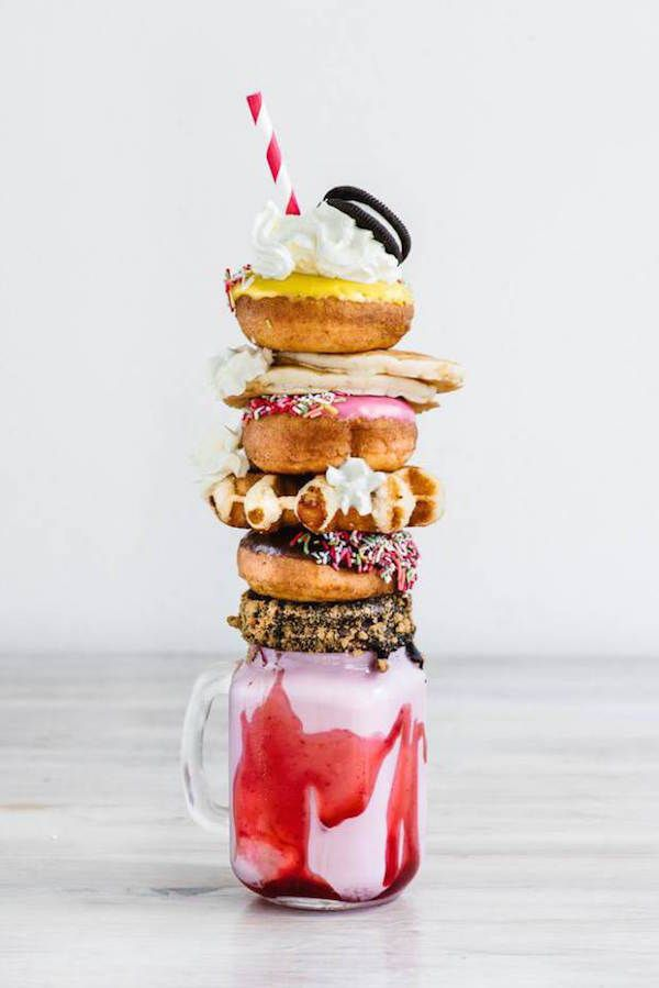 OMG this is the most insane milkshake I have ever seen. Filled with donuts, oreos, cream, pancakes and more.. #foodporn #deathbydonut #dessert
