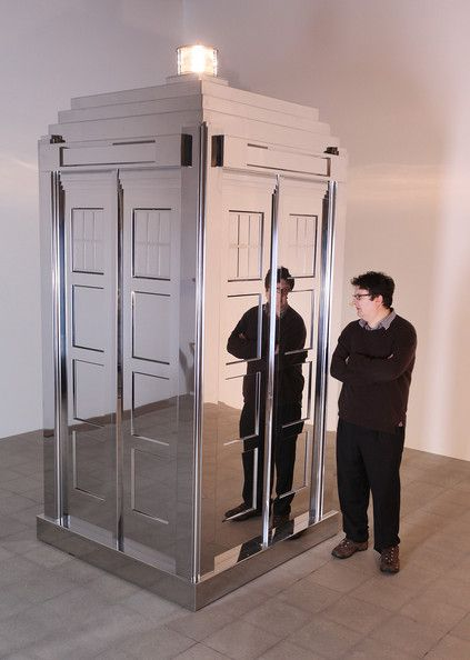 Mark Wallinger (Turner Prize winner 2007) stands with his life-sized mirrored Tardis sculpture on February 11, 2009 in London.