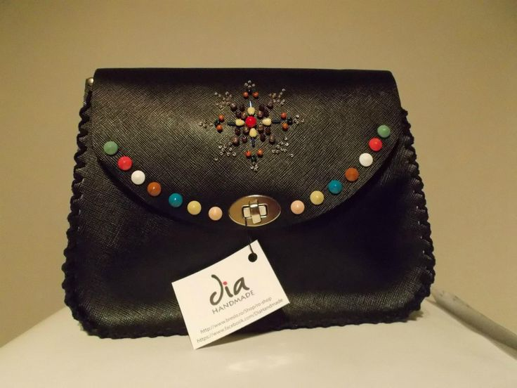 Unique handmade leather bag sewn with beads