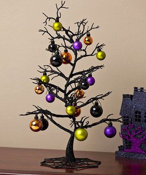 Spooky! Add chilling charm to décor with this enchanting tree. Featuring colorful ornaments, it brings a bright pop to seasonal parties.