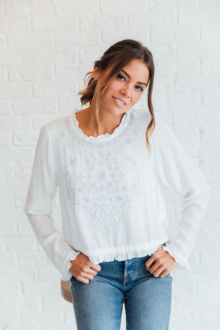 DETAILS: - Embroidered Back Tie Blouse - Fabric Content: 100% RAYON - Model is wearing a small - Cropped top - Bust: S= 37 in, M= 39 in, L= 39.5 in - Waist: S= 38 in, M= 40 in, L= 42 in - Length: S= 1
