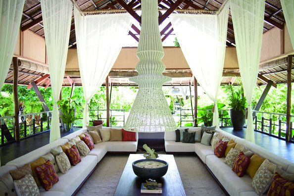 Love the patterned pillows in this Asian-inspired, super chic space