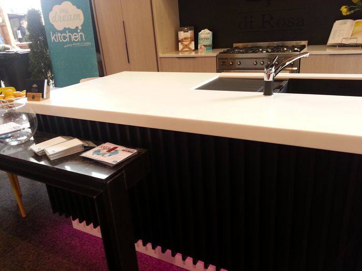 Melteca Black Puregrain cabinetry on island front and Laminex Solid Surface Stratus bench top My Dream Kitchen Designed and manufactured by Di Rosa Cabinetry & Furniture, table and bench top fabricated by Pacific Stone