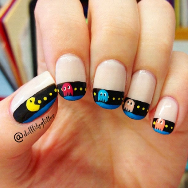 Pacman Nails hahahaha but if you are old enough to remember pacman you are probably too old to have your nails done this way!