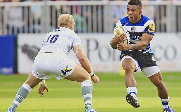 Come and get me: Bath's Kyle Eastmond (right) attacks Shane Geraghty of London Irish