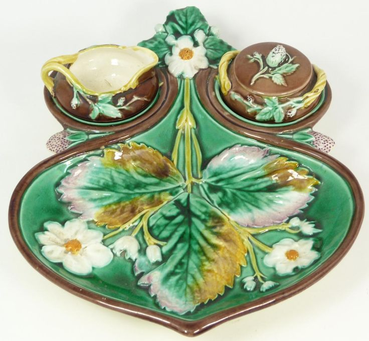 KL+WEDGWOOD MAJOLICA STRABERRY DISH w SUGAR CREAMER Antique Wedgwood English Majolica earthenware strawberry dish. Dish has fitted recesses for holding a covered sugar and creamer. Holds impressed Wedgwood mark to bottom with impressed registration mark. Also has impressed FFZ M. 19th century.
