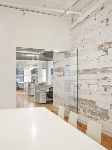 This office space and conference room is sleek and modern with glass doors and woodwork. #office #medicaloffice #dentaloffice   EDUN Americas, Inc. Showroom & Offices / Spacesmith