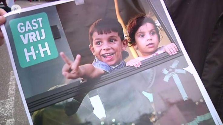 Buurtbewoners ontvangen eerste vluchtelingen met open armen
