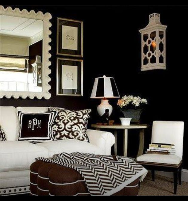 This image shows a more modern look at some of RL's living/formal room decor. They also utilize monograms and prints in the pillows and throw pillow.