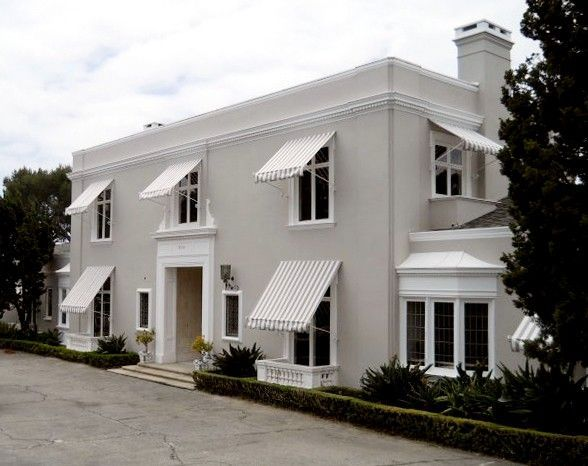 Gray and white Bel-Air house with awnings