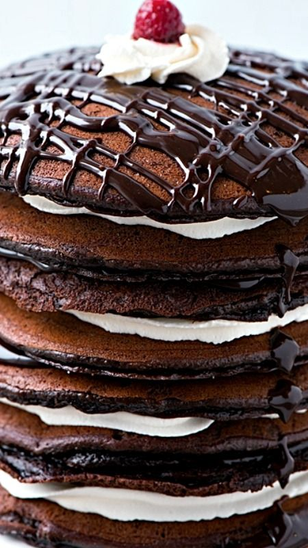 Black-and-White Pancake Cake ~ Mind-blowing dessert... Maple-sweetened chocolate cake batter is cooked up like pancakes into thin layers and then sandwiched with lots of maple cream.