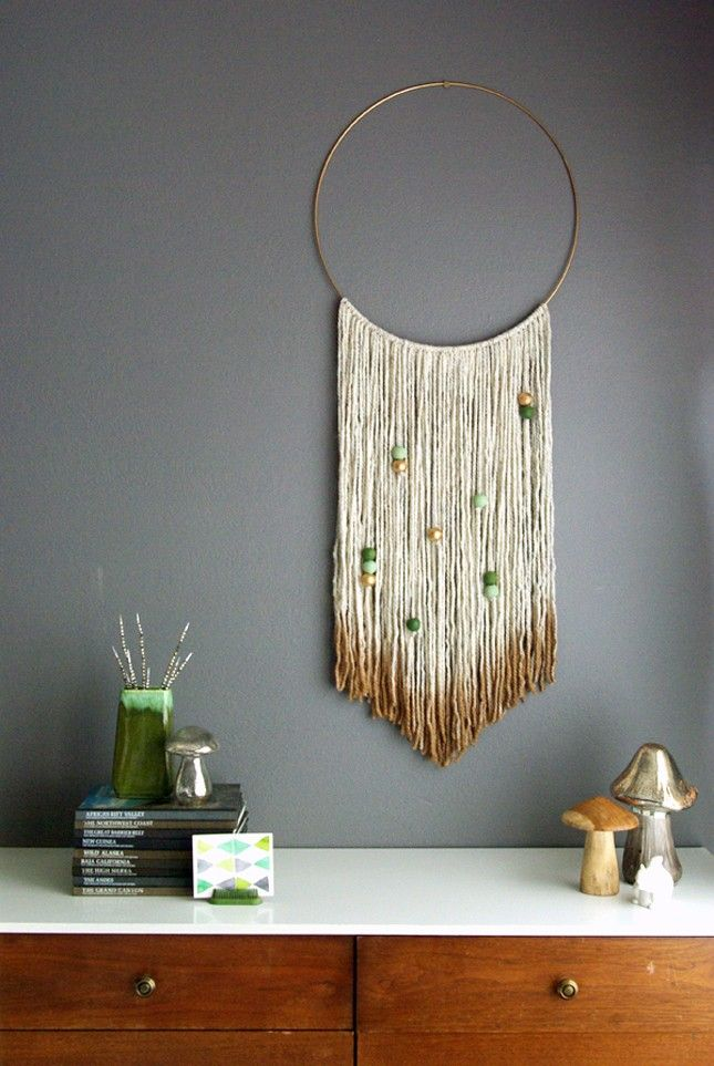 Dip dye yarn to achieve this cool DIY wall hanging.