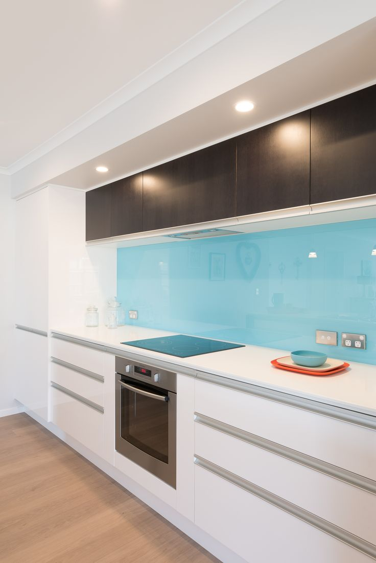 A splash of baby blue colour to go with the sleek white Corian benchtops. Found in our Far North show home