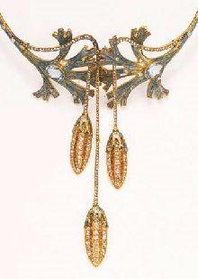 AN IMPORTANT ART NOUVEAU 'ALGAE' NECKLACE BY GEORGES FOUQUET. Composed of gold, enamel, diamond, opal, hessonite garnet. Circa 1905. In its original box, signed G. Fouquet , 6 Rue Royale, Paris. #ArtNouveau #Fouquet #necklace