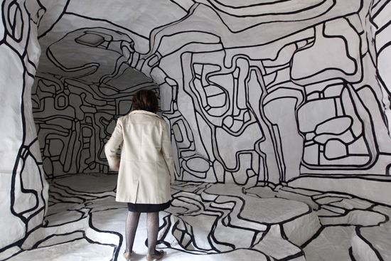 (Line/shape on roll paper to create environment?) A woman looks at 'Le jardin d'Hiver,' 1968-1970, a work by French artist Jean Dubuffet in the new permanent collection of the national Modern Art Museum at the Georges Pompidou center on April 5 in Paris. Photo by Francois Guillot/ AFP/ Getty Images