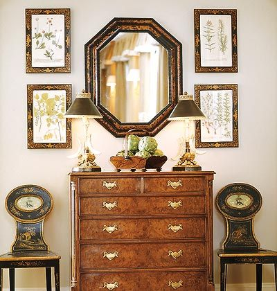 Botanicals, mirror & antique dresser form lovely vignette in Southern Accents Magazine