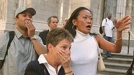 """""""Image shows 3 strong emotions combined in a single moment. Three people watching the World Trade Center Towers Collapse on September 11, 2001.  Elevated positions of eyelids, eye brows, foreheads are consistent with surprise and fear. These are most pronounced and evident in the women. Surprise is the most fleeting of all emotions, almost always followed by another strong emotion such as fear, anger or embarrassment. Woman pointing (per mouth posture) is transitioning from surprise to…"""