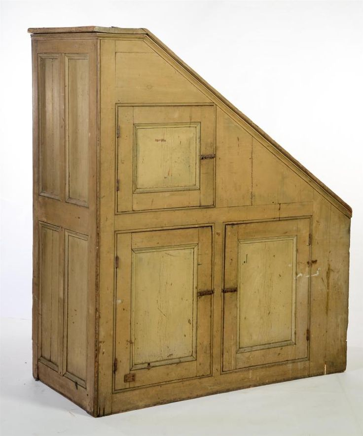 "<b>UNDER-THE-STAIRS CUPBOARD.</b> <br /> Ohio, 2nd quarter-19th century, pine. Original mustard paint. Three doors with applied molding match the four panels on the tall side of the piece. Cornice molding at the top, beading around door openings and down the side. Red wash interior. 68""h. (tall end), 33""h. (short end), 58""w. 28""d. <br /> <br /> Sold at Garth's, February 11, 2006, lot 581."