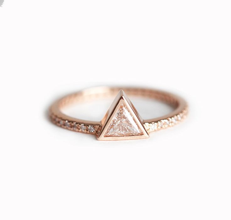 0.3 carat Trillion Diamond ring, Triangle Diamond Ring with pave diamonds, Pave Engagement Ring, 18k Solid Gold Engagement Ring by MinimalVS on Etsy https://www.etsy.com/listing/241310521/03-carat-trillion-diamond-ring-triangle
