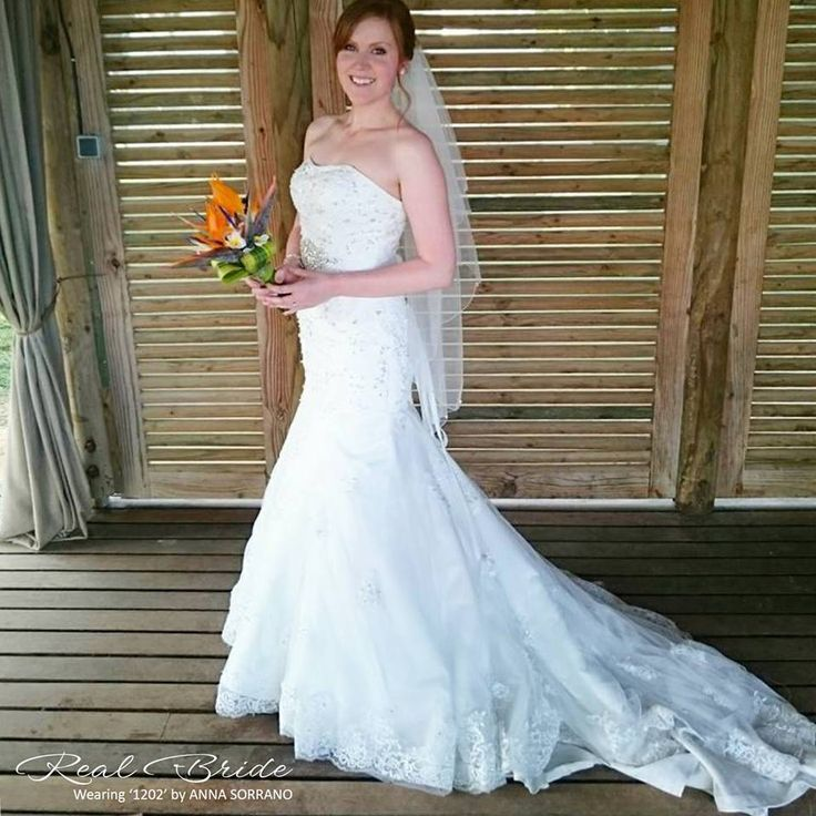 What a beautiful photo of Hazel on her wedding day in '1202' Wedding dress 💕 Could this stunning lace fishtail be your dream wedding dress? 💕