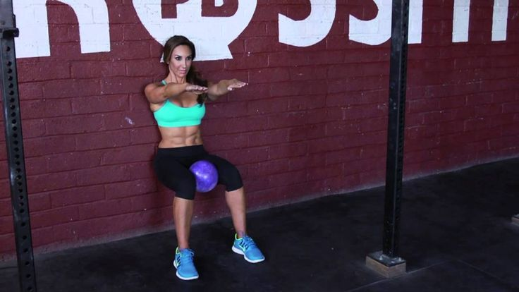 wall-squat-with-ball-between-knees