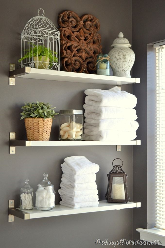 Installing IKEA EKBY shelves in the bathroom of Frugal Homemaker blog.