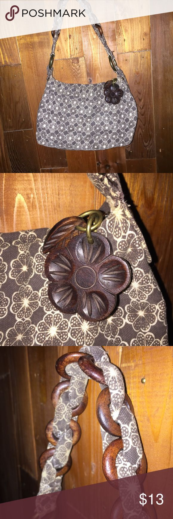 Gap handbag with wooden embellishments This stunning Gap handbag has a lovely wooden flower and a small leaf that matches the pattern on the fabric.  It has some scratches on the wooden rings in the handle and shows some wear on the inside. GAP Bags Hobos