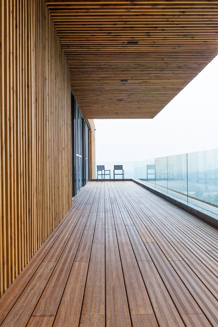 Terrace with glass fence at Spa-Clubhouse, Garden Valley - Mei Jie Mountain Hotspring resort in Liyang, China. by AchterboschZantman architecten