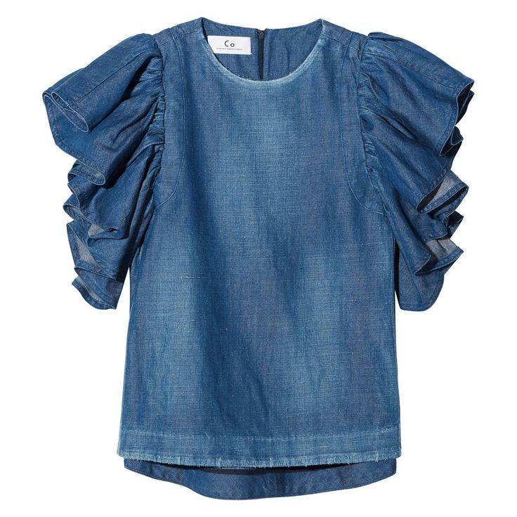 Feminine with a rugged edge in blue denim, this blouse flawlessly combines structure with delicate, fluttery sleeves—it's a brilliant, almost seasonless...