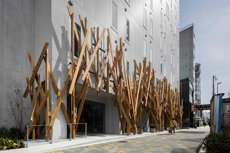 the japanese architect has completed the façade and interior design of a 10-storey hotel located near tokyo\'s skytree observation tower.