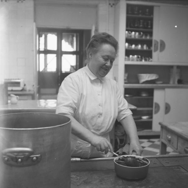 """Eugénie Brazier, dite """"la Mère Brazier"""" dans sa cuisine  auteur(s) Vallet, Marcelle, 1907-2000 (photographe)Les Mères Lyonnaises - pioneers of fine Lyonnais cooking. Pictured: Eugénie Brazier, whose two restaurants both earned 3 Michelin stars"""