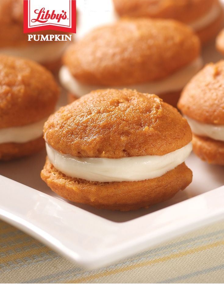 It's yummy cream cheese filling between two moist pumpkin cookies! This Mini Pumpkin Whoopie Pie recipe is irresistible and fun to make with your kids in the kitchen.