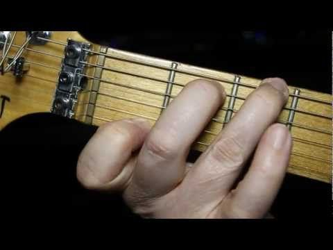 How to play guitar chords - LEFT HANDED absolute beginners guitar lesson - YouTube
